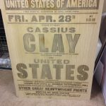 Laser engraved poster student artwork of Cassius Clay vs United States onto solid wood.